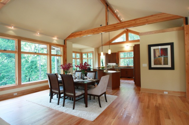 area rugs can define spaces in large open floor plans such as this dining area